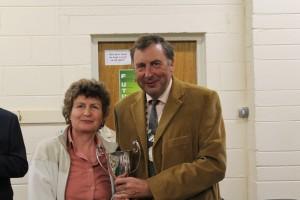 Maria Tobin getting her award from Eamon McGee FIBKA president