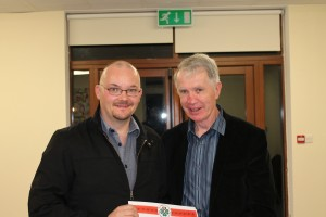 Patrick Cronin receiving his preliminary certificate from Michael O Callaghan